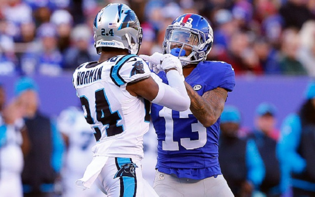 EAST RUTHERFORD, NJ - DECEMBER 20: (NEW YORK DAILIES OUT) Josh Norman #24 of the Carolina Panthers and Odell Beckham #13 of the New York Giants get involved after a play during the first half on December 20, 2015 at MetLife Stadium in East Rutherford, New Jersey. The Panthers defeated the Giants 38-35. (Photo by Jim McIsaac/Getty Images)