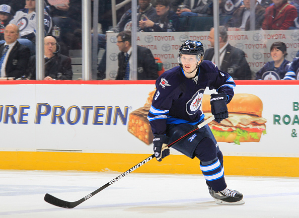 WINNIPEG, MB - MARCH 30: Jacob Trouba #8 of the Winnipeg Jets follows the play down the ice during first period action against the Ottawa Senators at the MTS Centre on March 30, 2016 in Winnipeg, Manitoba, Canada. The Sens defeated the Jets 2-1. (Photo by Darcy Finley/NHLI via Getty Images)