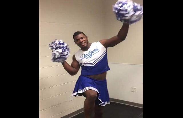 Here's Yasiel Puig dressed up as a cheerleader, cheering ...