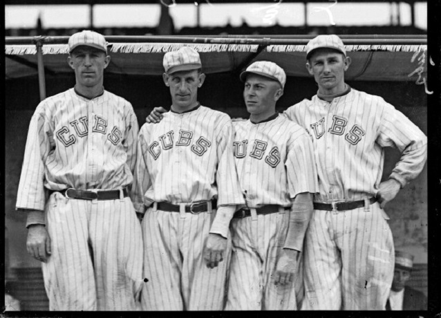 Chicago Cubs baseball players Merkle, Zeider, Charles Hollocher, and Deal standing in front of a dugout at Weeghman Park, Chicago, Illinois, 1918. Weeghman Park was renamed Wrigley Field in 1927. (Photo by Chicago History Museum/Getty Images)