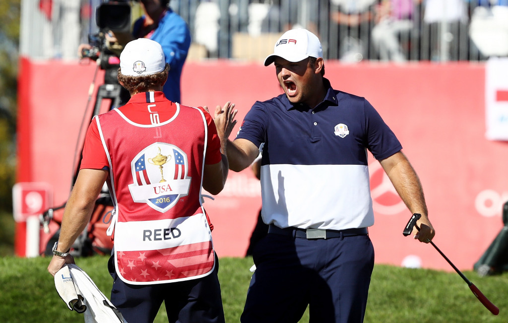 CHASKA, MN - OCTOBER 02: Patrick Reed of the United States celebrates with caddie Kessler Karain after winning his match on the 18th green during singles matches of the 2016 Ryder Cup at Hazeltine National Golf Club on October 2, 2016 in Chaska, Minnesota.  (Photo by Sam Greenwood/Getty Images)