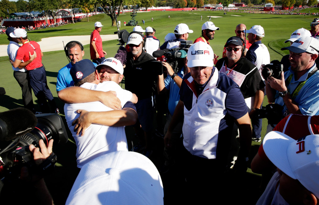 CHASKA, MN - OCTOBER 02: Captain Davis Love III of the United States celebrates with Ryan Moore and Phil Mickelson on the 18th green after winning the Ryder Cup during singles matches of the 2016 Ryder Cup at Hazeltine National Golf Club on October 2, 2016 in Chaska, Minnesota.  (Photo by Sam Greenwood/Getty Images)