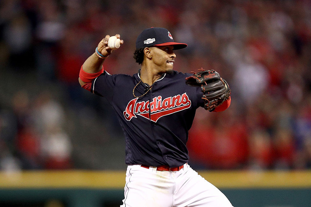 CLEVELAND, OH - OCTOBER 14: Francisco Lindor #12 of the Cleveland Indians throws to first base to force out Kevin Pillar #11 of the Toronto Blue Jays in the seventh inning during game one of the American League Championship Series at Progressive Field on October 14, 2016 in Cleveland, Ohio. (Photo by Maddie Meyer/Getty Images)