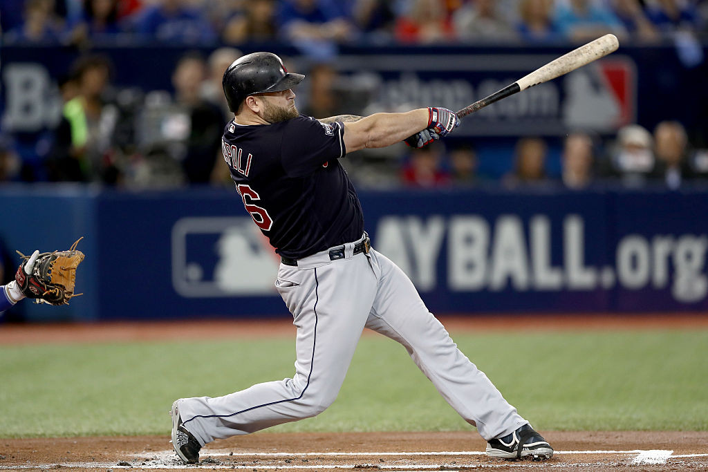 TORONTO, ON - OCTOBER 19:  Mike Napoli #26 of the Cleveland Indians hits a double to score Francisco Lindor #12 in the first inning against Marco Estrada #25 of the Toronto Blue Jays during game five of the American League Championship Series at Rogers Centre on October 19, 2016 in Toronto, Canada.  (Photo by Elsa/Getty Images)