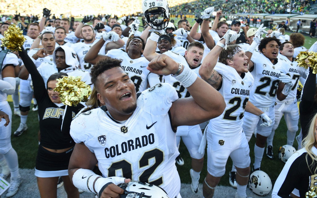 EUGENE, OR - SEPTEMBER 24: Defensive end Jordan Carrell #92 of the Colorado Buffaloes celebrates with his teammates after the game against the Oregon Ducks at Autzen Stadium on September 24, 2016 in Eugene, Oregon. Colorado won the game 41-38. (Photo by Steve Dykes/Getty Images)