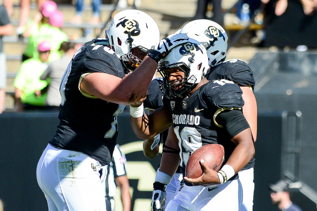 BOULDER, CO - OCTOBER 1:  Running back Michael Adkins II #19 of the Colorado Buffaloes celebrates with offensive lineman Shane Callahan #70 after scoring a second half rushing touchdown against the Oregon State Beavers at Folsom Field on October 1, 2016 in Boulder, Colorado.  (Photo by Dustin Bradford/Getty Images)