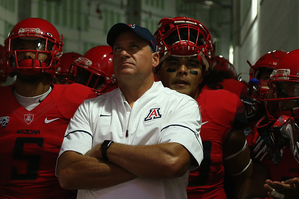GLENDALE, AZ - SEPTEMBER 03:  Head coach Rich Rodriguez of the Arizona Wildcats leads his team onto the field before the college football game against the Brigham Young Cougars at University of Phoenix Stadium on September 3, 2016 in Glendale, Arizona. The Cougars defeated the Wildcats 18-16.  (Photo by Christian Petersen/Getty Images)