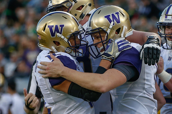 EUGENE, OR - OCTOBER 08:  Quarterback Jake Browning #3 (R) of the Washington Huskies is congratulated by wide receiver Aaron Fuller #12 after scoring a touchdown in the second quarter against the Oregon Ducks on October 8, 2016 at Autzen Stadium in Eugene, Oregon.  (Photo by Otto Greule Jr/Getty Images)