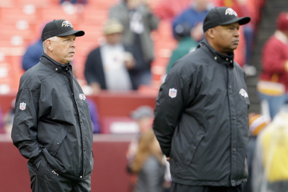 LANDOVER, MD - DECEMBER 09: Offensive coordinator Cam Cameron (L) and quarterbacks coach Jim Caldwell (R) of the Baltimore Ravens watch as the team warms up prior to the start of the Ravens game against the Washington Redskins at FedExField on December 9, 2012 in Landover, Maryland.  (Photo by Rob Carr/Getty Images)
