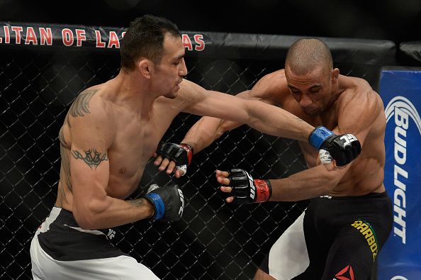 LAS VEGAS, NV - DECEMBER 11: (L-R) Tony Ferguson punches Edson Barboza in their lightweight bout during the TUF Finale event inside The Chelsea at The Cosmopolitan of Las Vegas on December 11, 2015 in Las Vegas, Nevada.  (Photo by Brandon Magnus/Zuffa LLC/Zuffa LLC via Getty Images)