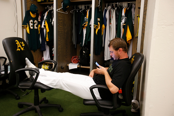 OAKLAND, CA - JULY 20: Sonny Gray #54 of the Oakland Athletics checks his phone in the clubhouse prior to the game against the Houston Astros at the Oakland Coliseum on July 20, 2016 in Oakland, California. The Astros defeated the Athletics 7-0. (Photo by Michael Zagaris/Oakland Athletics/Getty Images)