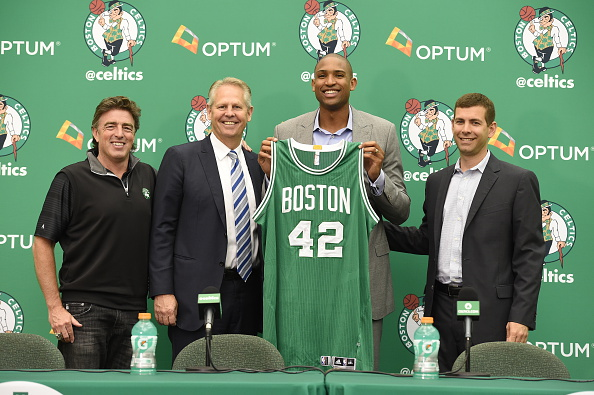 BOSTON, MA - JULY 8: (L-R) Wycliff Grousbeck, Danny Ainge and Brad Stevens welcome Al Horford, center, as the newest member of the Boston Celtics on July 8, 2016 at the Boston Celtics Practice Facility in Waltham, Massachusetts. (Photo by Brian Babineau/NBAE via Getty Images)