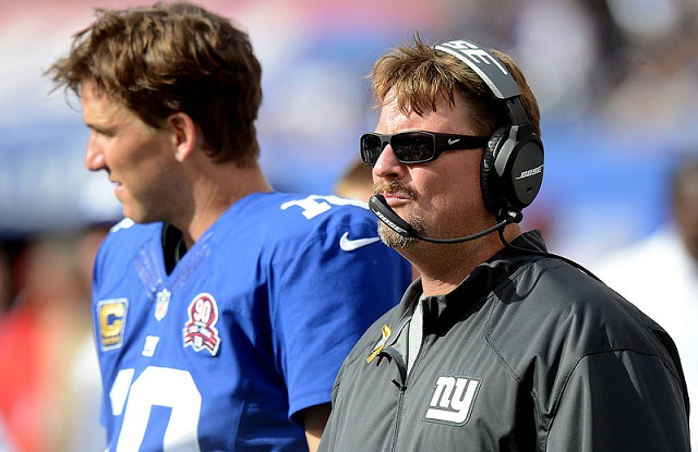 EAST RUTHERFORD, NJ - SEPTEMBER 14:  Offensive coordinator Ben McAdoo and quarterback Eli Manning #10 of the New York Giants look on from the sideline against the Arizona Cardinals during a game at MetLife Stadium on September 14, 2014 in East Rutherford, New Jersey.  (Photo by Ron Antonelli/Getty Images)