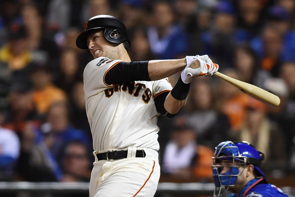 SAN FRANCISCO, CA - OCTOBER 10:  Buster Posey #28 of the San Francisco Giants hits an RBI single in the third inning during Game Three of their National League Division Series against the Chicago Cubs at AT&T Park on October 10, 2016 in San Francisco, California.  (Photo by Thearon W. Henderson/Getty Images)