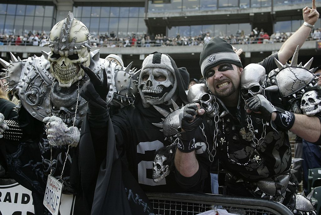 UNITED STATES - JANUARY 12:  Football: AFC playoffs, Closeup of painted Oakland Raiders fans in Black Hole during game vs New York Jets, Oakland, CA 1/12/2003  (Photo by V.J. Lovero/Sports Illustrated/Getty Images)  (SetNumber: X67546)
