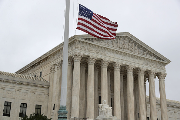 WASHINGTON, DC - SEPTEMBER 30:  A U.S. flag flies at half-staff outside the U.S. Supreme Court on September 30, 2016 in Washington, DC. The Supreme Court will return for a new term on Monday, October 3.  (Photo by Alex Wong/Getty Images)