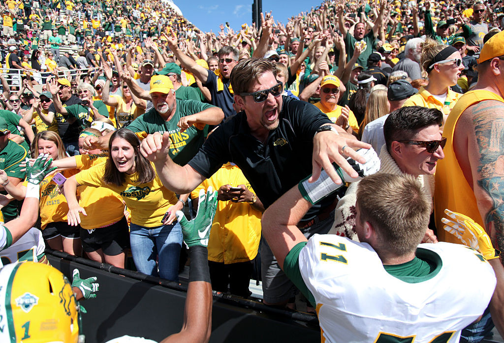 IOWA CITY, IOWA- SEPTEMBER 17: Fans celebrate with cornerback Darren Kelley #11 of the North Dakota State Bisons after the upset over the Iowa Hawkeyes on September 17, 2016 at Kinnick Stadium in Iowa City, Iowa. (Photo by Matthew Holst/Getty Images)