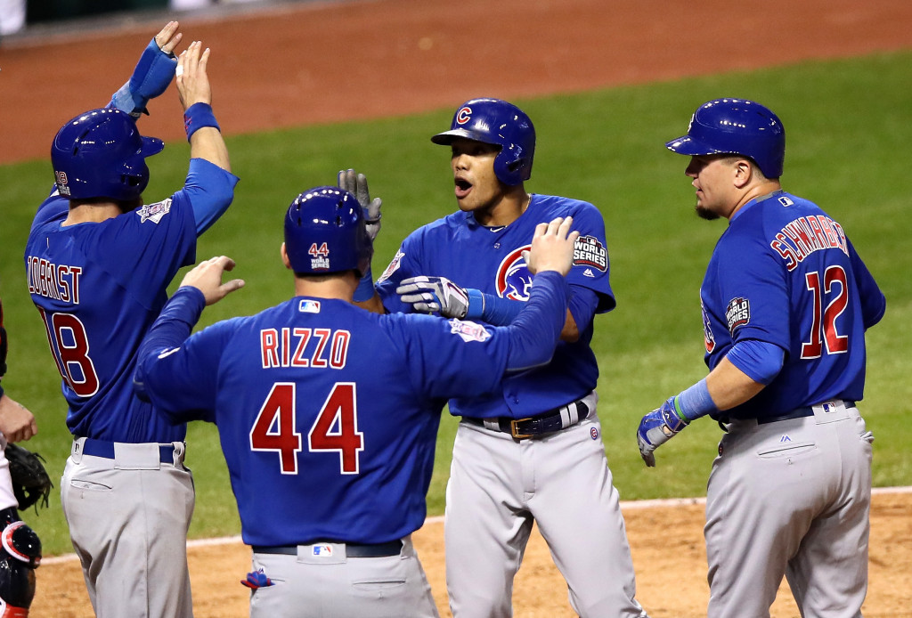 CLEVELAND, OH - NOVEMBER 01:  Addison Russell #27 of the Chicago Cubs celebrates with Anthony Rizzo #44, Ben Zobrist #18 and Kyle Schwarber #12 after hitting a grand slam home run during the third inning against the Cleveland Indians in Game Six of the 2016 World Series at Progressive Field on November 1, 2016 in Cleveland, Ohio.  (Photo by Ezra Shaw/Getty Images)