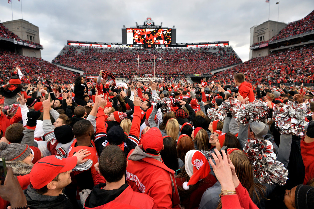 COLUMBUS, OH - NOVEMBER 26:   Ohio State Buckeyes fans celebrate after defeating the Michigan Wolverines at Ohio Stadium on November 26, 2016 in Columbus, Ohio.  (Photo by Jamie Sabau/Getty Images)