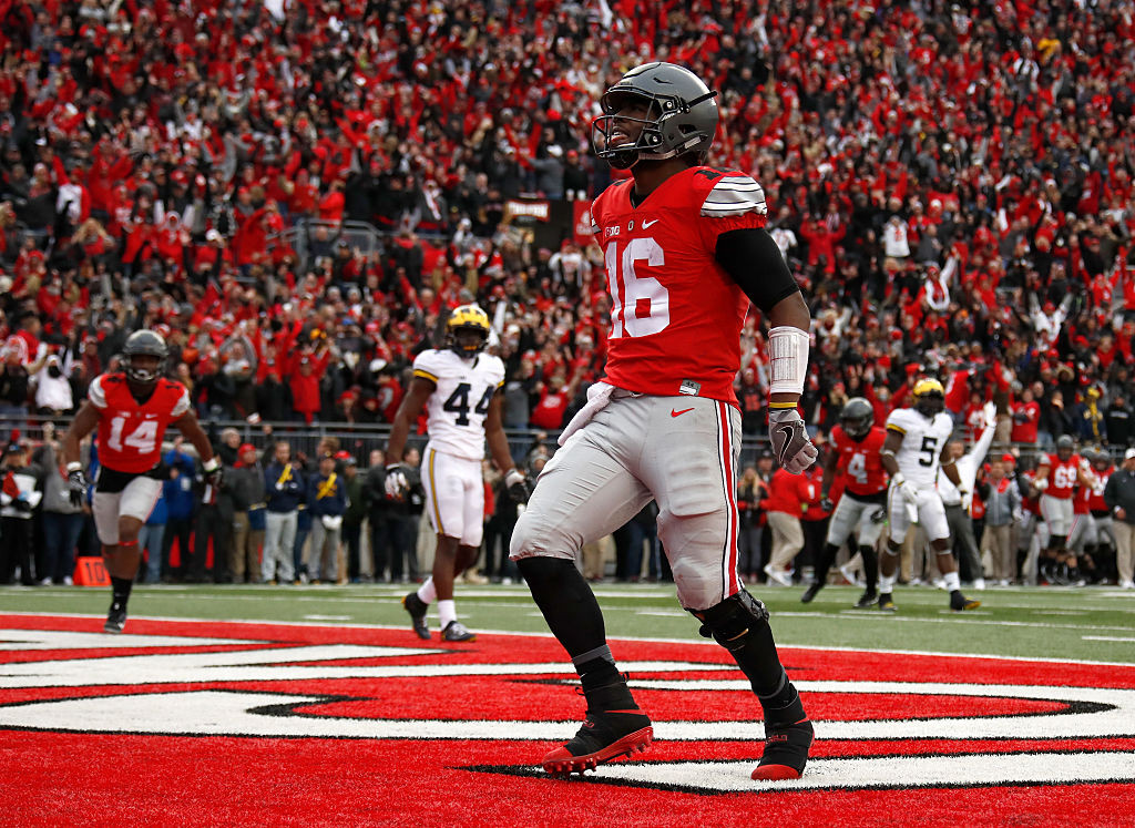 COLUMBUS, OH - NOVEMBER 26:   J.T. Barrett #16 of the Ohio State Buckeyes celebrates after rushing for a touchdown in overtime against the Michigan Wolverines at Ohio Stadium on November 26, 2016 in Columbus, Ohio.  (Photo by Gregory Shamus/Getty Images)