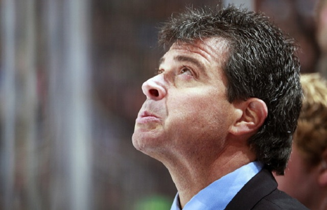 VANCOUVER, BC - MARCH 10:  Head coach Jack Capuano of the New York Islanders looks on from the bench during their NHL game against the Vancouver Canucks at Rogers Arena March 10, 2014 in Vancouver, British Columbia, Canada.  (Photo by Jeff Vinnick/NHLI via Getty Images)