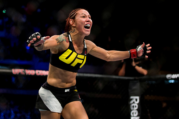 CURITIBA, BRAZIL - MAY 14:  Cris 'Cyborg' Justino of Brazil celebrates after defeating Leslie Smith of the United States in their catchweight bout during the UFC 198 at Arena da Baixada stadium on May 14, 2016 in Curitiba, Brazil. (Photo by Buda Mendes/Zuffa LLC/Zuffa LLC via Getty Images)