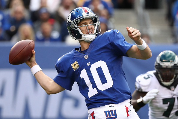 EAST RUTHERFORD, NJ - NOVEMBER 06:  Eli Manning #10 of the New York Giants throws the ball against the Philadelphia Eagles during the second quarter of the game at MetLife Stadium on November 6, 2016 in East Rutherford, New Jersey.  (Photo by Al Bello/Getty Images)