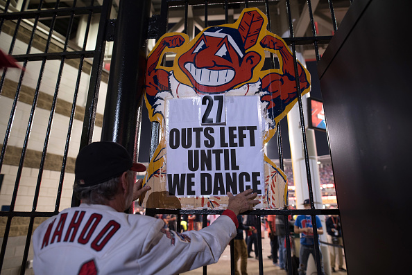 CLEVELAND, OH - NOVEMBER 01: Jim Stamper of Cleveland hangs a sign outside of Progressive Field during game 6 of the World Series against the Chicago Cubs on November 1, 2016 in Cleveland, Ohio. The Cleveland Indians are one victory away from their first World Series championship since 1948. (Photo by Justin Merriman/Getty Images)