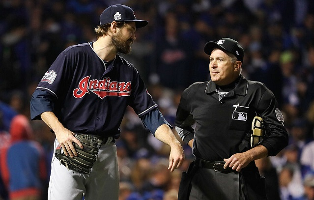 CHICAGO, IL - OCTOBER 28: Andrew Miller #24 of the Cleveland Indians talks with umpire John Hirschbeck in the sixth inning against the Chicago Cubs in Game Three of the 2016 World Series at Wrigley Field on October 28, 2016 in Chicago, Illinois. (Photo by Jamie Squire/Getty Images)