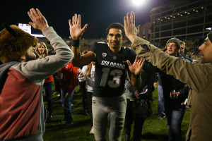 BOULDER, CO - NOVEMBER 19:  quarterback Sefo Liufau #13 of the Colorado Buffaloes celebrates on the field with fans after defeating the Washington State Cougars 38-24 at Folsom Field on November 19, 2016 in Boulder, Colorado. (Photo by Justin Edmonds/Getty Images)