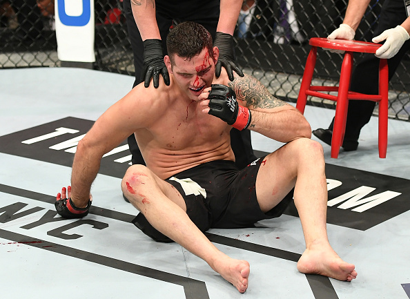 NEW YORK, NY - NOVEMBER 12:  Chris Weidman of the United States sits on the floor after his KO defeat to Yoel Romero of Cuba (not pictured) in their middleweight bout during the UFC 205 event at Madison Square Garden on November 12, 2016 in New York City.  (Photo by Jeff Bottari/Zuffa LLC/Zuffa LLC via Getty Images)