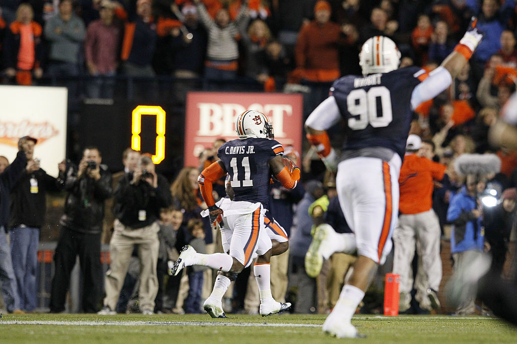 AUBURN, AL - NOVEMBER 30: Chris Davis #11 of the Auburn Tigers returns a missed field goal for the winning touchdown in their 34 to 28 win over the Alabama Crimson Tide at Jordan-Hare Stadium on November 30, 2013 in Auburn, Alabama. (Photo by Kevin C. Cox/Getty Images)