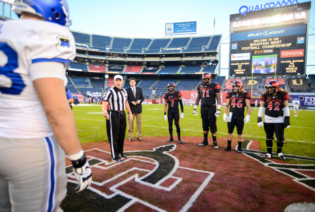 SAN DIEGO, CA - DECEMBER 05:   Captains J.J. Whittaker #7, Pearce Slater #71, Jay Henderson #46 and Jake Fely #42 of the San Diego State Aztecs await the referee's coin toss prior to playing the Mountain West Championship game against the Air Force Falcons at Qualcomm Stadium on December 5, 2015 in San Diego, California.  (Photo by Kent Horner/Getty Images)