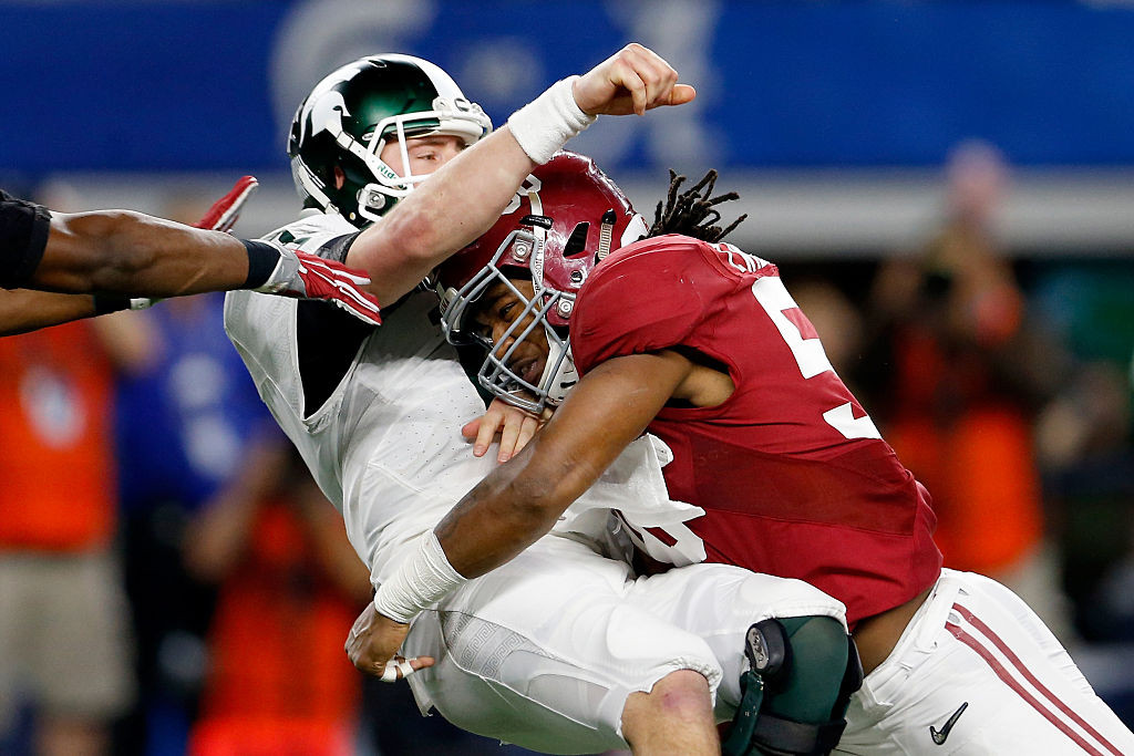 ARLINGTON, TX - DECEMBER 31: Tim Williams #56 of the Alabama Crimson Tide sacks Connor Cook #18 of the Michigan State Spartans in the second half during the Goodyear Cotton Bowl at AT&T Stadium on December 31, 2015 in Arlington, Texas. (Photo by Ron Jenkins/Getty Images)