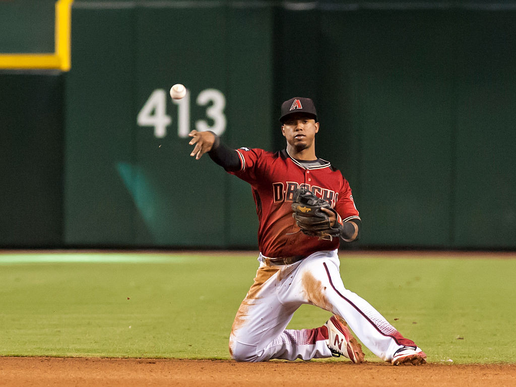 PHOENIX, AZ - SEPTEMBER 18: After making a diving stop, Jean Segura #2 of the Arizona Diamondbacks throws the runner out from his knees during the MLB game against the Los Angeles Dodgers at Chase Field on September 18, 2016 in Phoenix, Arizona. (Photo by Darin Wallentine/Getty Images)