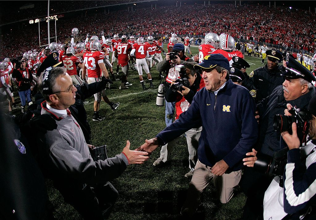 COLUMBUS, OH - NOVEMBER 18: Head coach Jim Tressel of the Ohio State Buckeyes is congratulated by head coach Lloyd Carr of the Michigan Wolverines November 18, 2006 at Ohio Stadium in Columbus, Ohio. Ohio State won 42-39. (Photo by Gregory Shamus/Getty Images)