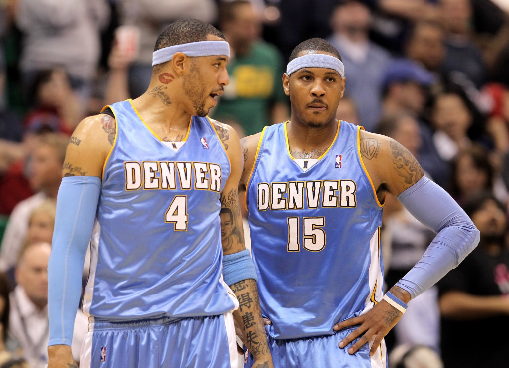 SALT LAKE CITY - APRIL 30:  Kenyon Martin #4 of the Denver Nuggets speaks to teammate Carmelo Anthony #15 during their loss to the Utah Jazz in Game Six of the Western Conference Quarterfinals of the 2010 NBA Playoffs at EnergySolutions Arena on April 30, 2010 in Salt Lake City, Utah. NOTE TO USER: User expressly acknowledges and agrees that, by downloading and or using this photograph, User is consenting to the terms and conditions of the Getty Images License Agreement.  (Photo by Ezra Shaw/Getty Images)