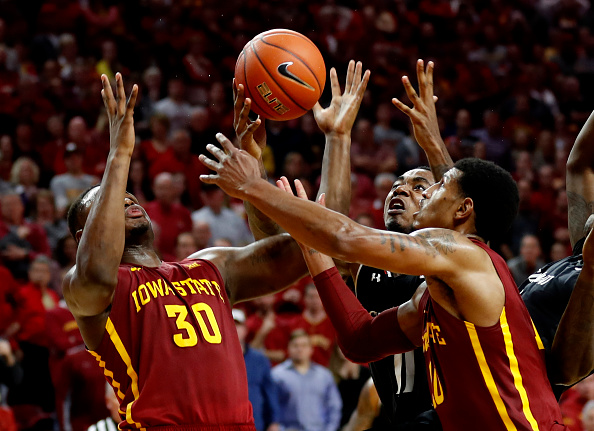 AMES, IA - DECEMBER 1:  Deonte Burton #30, and Darrell Bowie #10 of the Iowa State Cyclones, battle with Gary Clark #11 of the Cincinnati Bearcats for a rebound in the second half of play at Hilton Coliseum on December 1, 2016 in Ames, Iowa. The Cincinnati Bearcats won 55-54 over the Iowa State Cyclones. (Photo by David K Purdy/Getty Images)