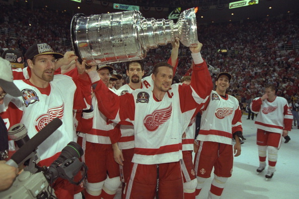 Hockey - Detroit Red Wings Steve Yzerman holds the Stanley Cup trophy aloft as he and his teammates celebrate their of the Philadelphia Flyers in the 1997 Stanley Cup Finals. The Red Wings beat the Flyers 2-1 in Detroit on June 7, 1997, to win their first league championship in 42 years.  (Photo by Albert Dickson/Sporting News via Getty Images)
