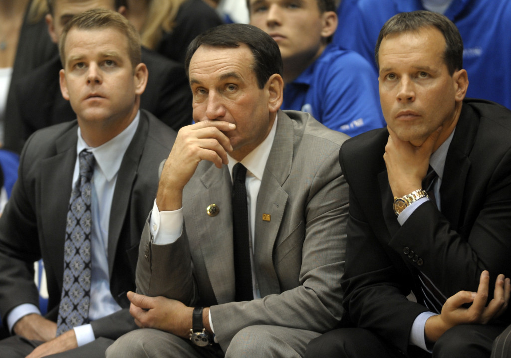 DURHAM, NC - NOVEMBER 12:    Duke's head coach Mike Krzyzewski (C) and associate head coaches Steve Wojoiechowski (L) and Chris Collins watch their team during an NCAA game against Presbyterian Blue Hose on November 12, 2011 in Durham, North Carolina. Duke won 96-55 over Presbyterian tying head coach Mike Krzyzewski with Bobby Knight for the most wins in NCAA Division I basketball.  (Photo by Sara D. Davis/Getty Images)
