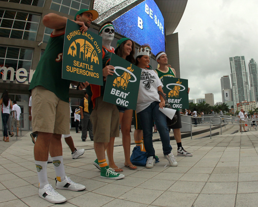 MIAMI, FL - JUNE 19:  Fans of the former NBA franchise Seattle SuperSonics which moved and became the Oklahoma City Thunder shows support for the Miami Heat to beat the Thunder in Game Four of the 2012 NBA Finals on June 19, 2012 at American Airlines Arena in Miami, Florida. (Photo by Ronald Martinez/Getty Images)