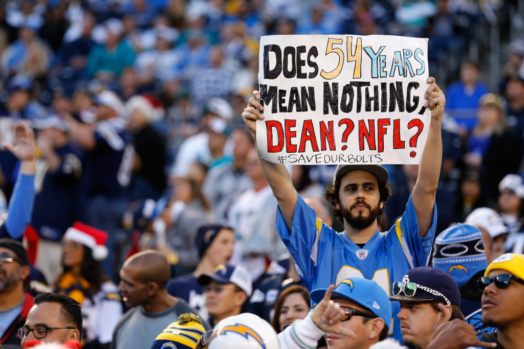 SAN DIEGO, CA - DECEMBER 20:  A fan holds a sign supporting the San Diego Chargers during a game against the Miami Dolphins at Qualcomm Stadium on December 20, 2015 in San Diego, California.  (Photo by Sean M. Haffey/Getty Images)