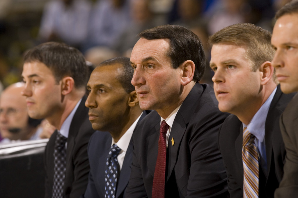 ATLANTA - JANUARY 10:  (L-R): Director of Basketball Operations Mike Schrage, assistant coach Johnny Dawkins, head coach Mike Krzyzewski and assistant coaches Steve Wojciechowski and Chris Collins of the Duke Blue Devils watch play from the bench during the first half against the Georgia Tech Yellow Jackets on January 10, 2007 at Alexander Memorial Coliseum in Atlanta, Georgia. Georgia Tech defeated Duke 74-63. (Photo by Paul Abell/Getty Images)
