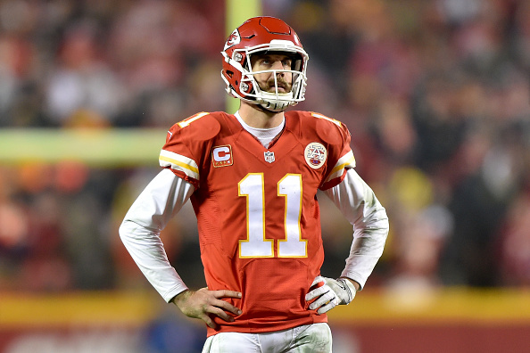 KANSAS CITY, MP - JANUARY 15: Quarterback Alex Smith #11 of the Kansas City Chiefs looks at the replay after a holding call negated a game tying two point conversion against the Pittsburgh Steelers during the fourth quarter in the AFC Divisional Playoff game at Arrowhead Stadium on January 15, 2017 in Kansas City, Missouri. (Photo by Peter Aiken/Getty Images)