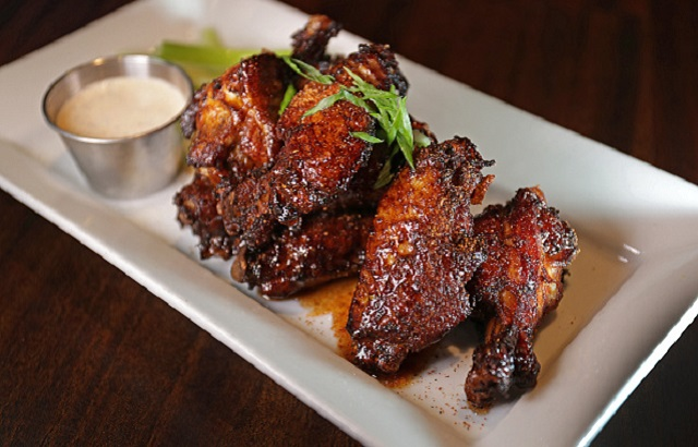 "WALTHAM, MA - NOVEMBER 22: ""Dirty"" Chicken Wings with Our Own Dry Rub, Agave and Buttermilk Ranch, pictured at Tempo Restaurant in Waltham, MA. (Photo by Barry Chin/The Boston Globe via Getty Images)"