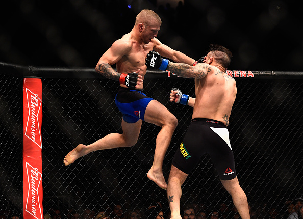 LAS VEGAS, NV - DECEMBER 30:  (L-R) TJ Dillashaw knees John Lineker of Brazil in their bantamweight bout during the UFC 207 event at T-Mobile Arena on December 30, 2016 in Las Vegas, Nevada.  (Photo by Jeff Bottari/Zuffa LLC/Zuffa LLC via Getty Images)