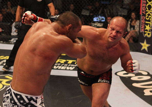 HOFFMAN ESTATES, IL - JULY 30:  (R-L) Fedor Emelianenko punches Dan Henderson during a heavyweight fight at the Strikeforce event at Sears Centre Arena on July 30, 2011 in Hoffman Estates, Illinois.  (Photo by Josh Hedges/Forza LLC/Forza LLC via Getty Images)