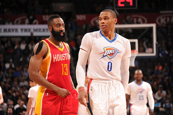 OKLAHOMA CITY, OK- APRIL 5:   James Harden #13 of the Houston Rockets and Russell Westbrook #0 of the Oklahoma City Thunder walk off the court on April 5, 2015 at Chesapeake Energy Arena in Oklahoma City, Oklahoma. (Photo by Bill Baptist/NBAE via Getty Images)