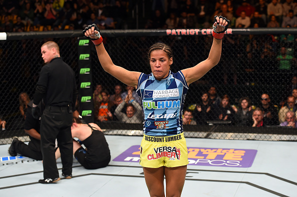 FAIRFAX, VA - APRIL 04:  (R-L) Juliana Pena celebrates after defeating Milana Dudieva in their women's bantamweight fight during the UFC Fight Night event at the Patriot Center on April 4, 2015 in Fairfax, Virginia. (Photo by Josh Hedges/Zuffa LLC/Zuffa LLC via Getty Images)