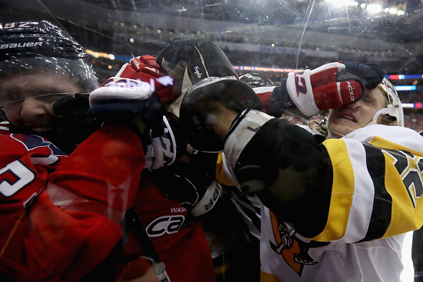 WASHINGTON, DC - JANUARY 11:  Evgeny Kuznetsov #92 of the Washington Capitals and Carl Hagelin #62 of the Pittsburgh Penguins fight in the third period at Verizon Center on January 11, 2017 in Washington, DC.  (Photo by Rob Carr/Getty Images)